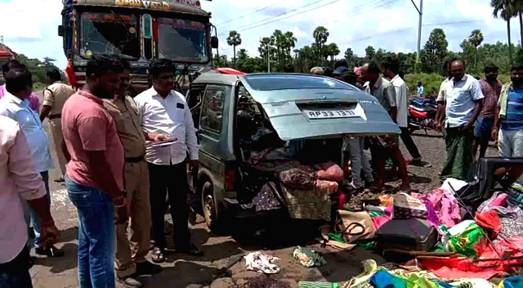 West Godavari: Locals gather at the site where a van rammed in to a truck at Nallajerla in West Godavari district of Andhra Pradesh on Sep 20, 2019.