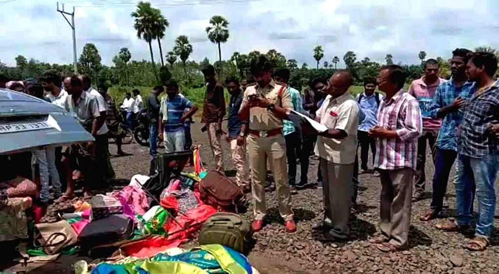 West Godavari: Police and locals gather at the site where a van rammed in to a truck at Nallajerla in West Godavari district of Andhra Pradesh on Sep 20, 2019. Reportedly 6 persons were killed and 5 ...
