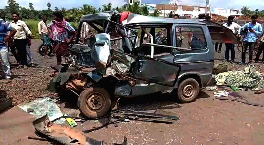 West Godavari: The mangled remains of a van that rammed into a truck at Nallajerla in West Godavari district of Andhra Pradesh on Sep 20, 2019. Reportedly 6 persons were killed and 5 injured in the ...
