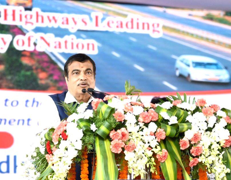 West Godavari: Union Transport Minister Nitin Gadkari addresses at the foundation stone laying ceremony of various National Highway (NH) projects including Rail Over Bridges (ROBs) under Setu ... - Nitin Gadkari