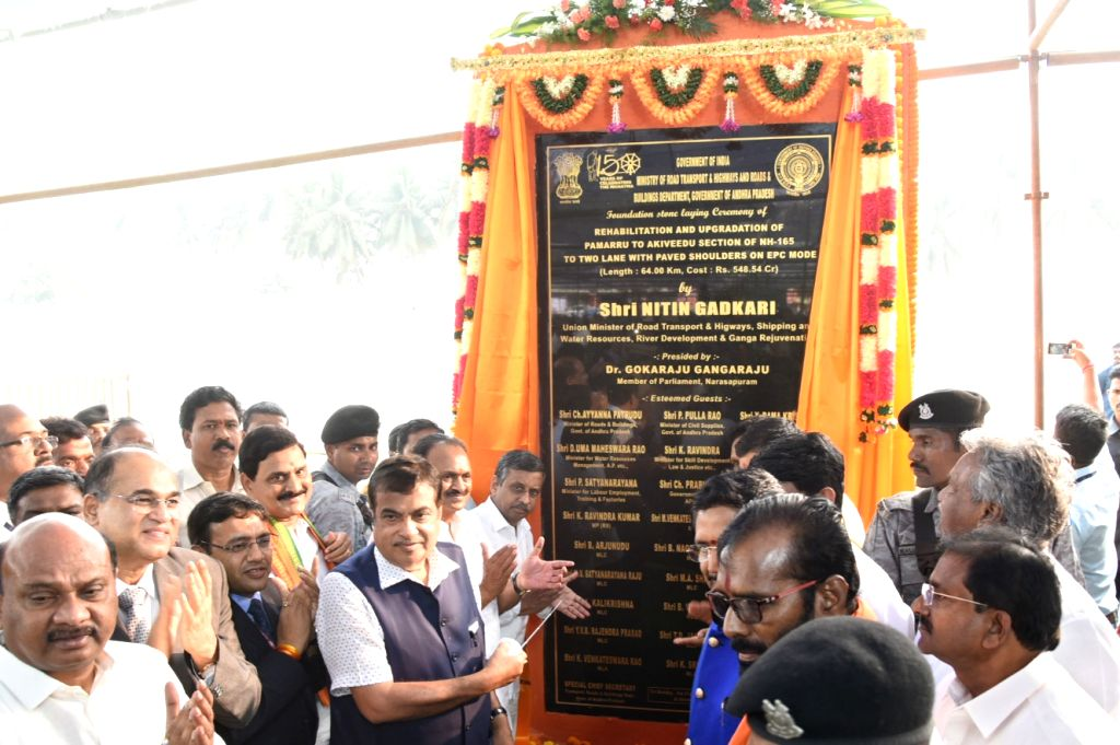 West Godavari: Union Transport Minister Nitin Gadkari unveils the plaque to lay the foundation stone for various National Highway (NH) projects including Rail Over Bridges (ROBs) under Setu Bharatam ... - Nitin Gadkari