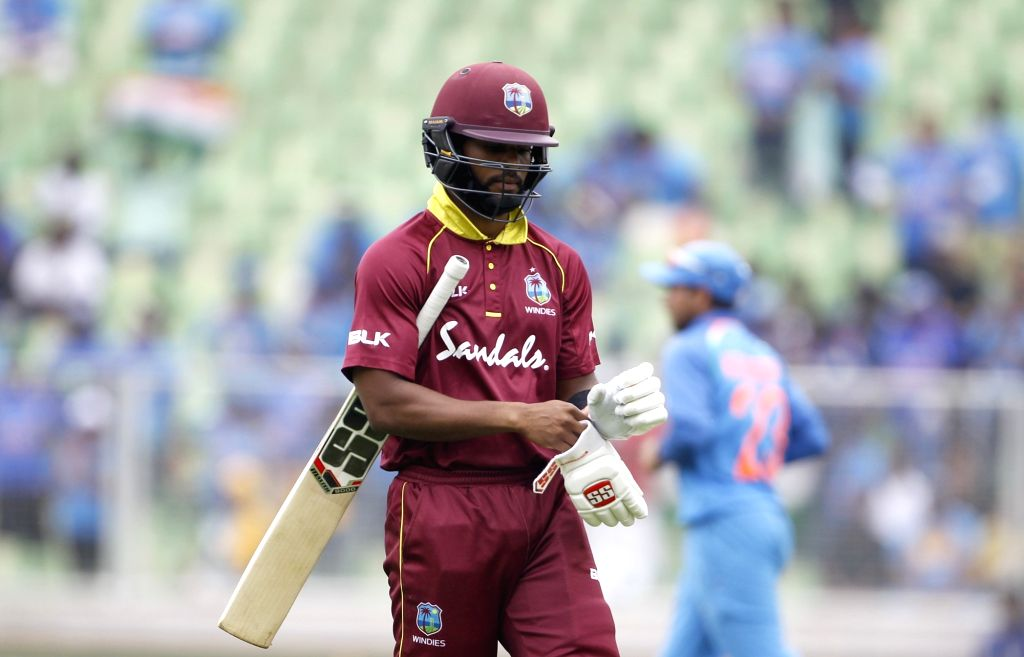 West Indies batsman Shai Hope goes back to pavilion after he was bowled out during the fifth and final One-Day International (ODI) match between India and West indies in ... - Shai Hope