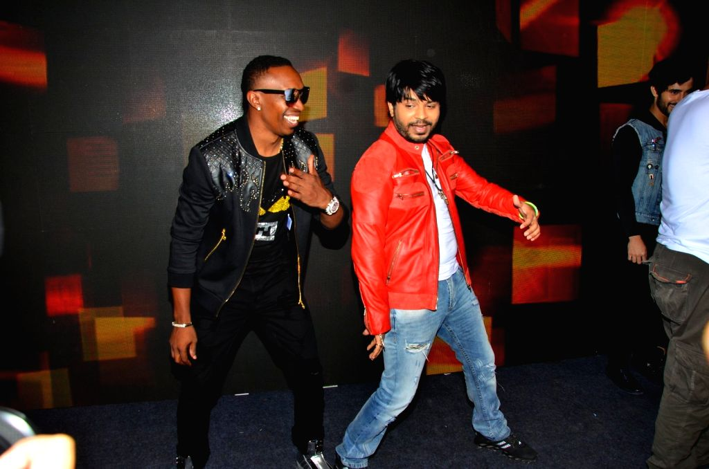 West Indies cricketer and singer Dwayne Bravo and singer Ankit Tiwari during the video shoot of a song for upcoming film Tum Bin 2 in Mumbai on Sept. 9, 2016.