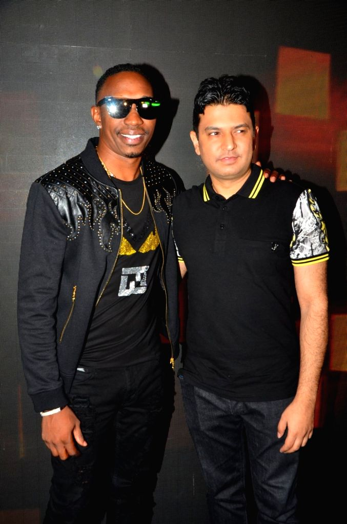 West Indies cricketer and singer Dwayne Bravo and filmmaker Bhusahn Kumar during the video shoot of a song for upcoming film Tum Bin 2 in Mumbai on Sept. 9, 2016. - Bhusahn Kumar