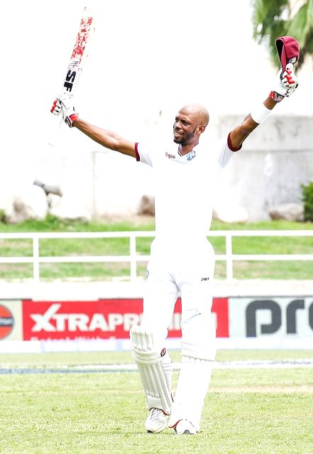 West Indies cricketer Roston Chase celebrates his century during the second test match between India and West Indies at Kingston, Jamaica, on Aug 4, 2016.