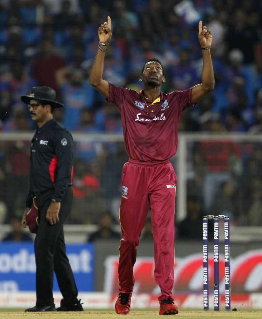 West Indies' Khary Pierre celebrates fall of KL Rahul's wicket during the second T20I match between India and West Indies at the Greenfield International Stadium in ...