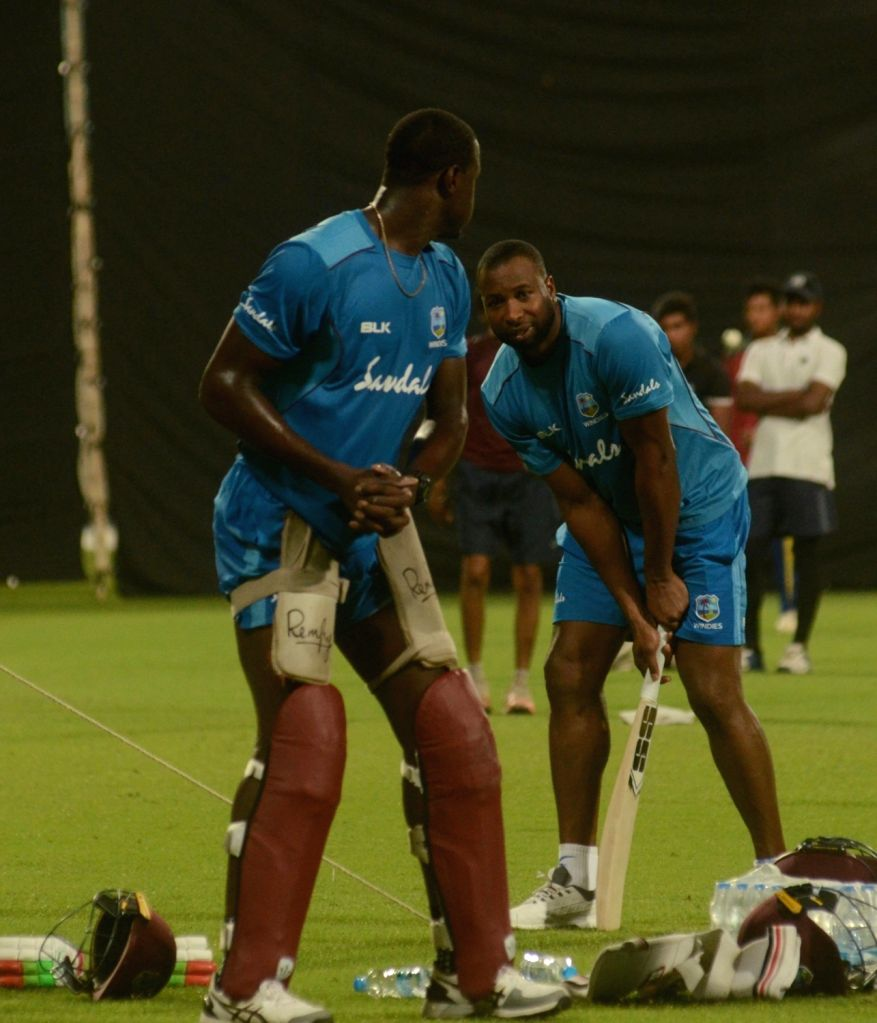 West Indies players Carlos Brathwaite and Kieron Pollard during a practice session ahead of their T20 match against India at the Eden Gardens in Kolkata on Nov. 1, 2018.