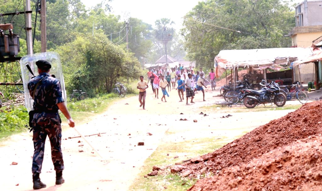 West Midnapore: Clashes broke out between stone-pelting protesters and security forces during the sixth phase of 2019 Lok Sabha elections, in West Midnapore on May 12, 2019.