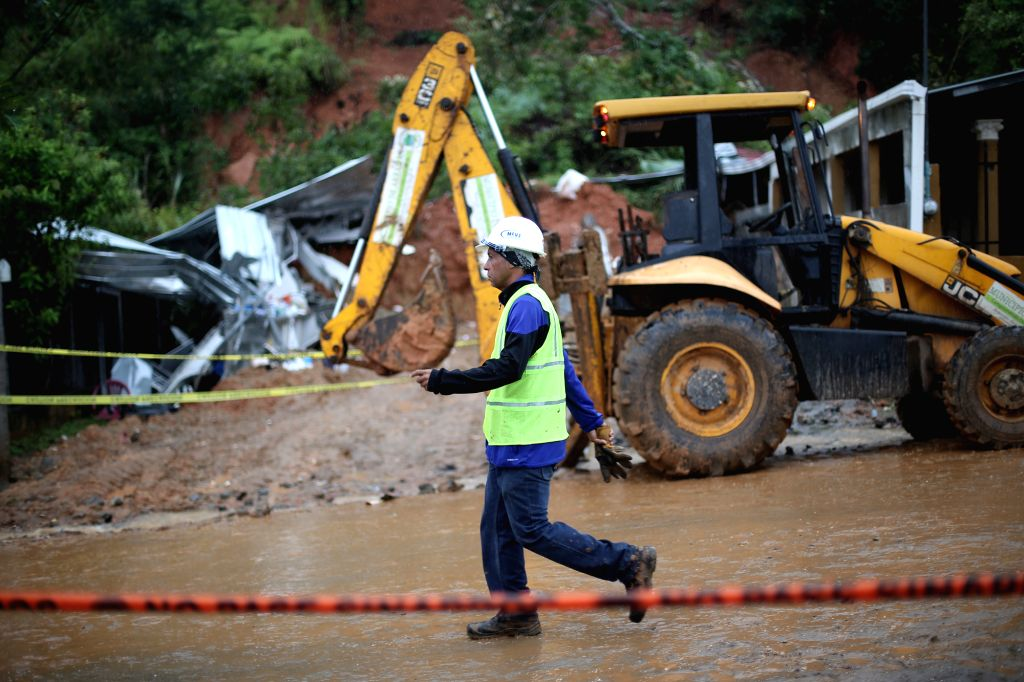 WEST PANAMA, Nov. 23, 2016 - A government personnel takes part in a rescue operation at the site of landslide in Arraijan, West Panama province, Panama, Nov. 22, 2016. According to local press, the ...