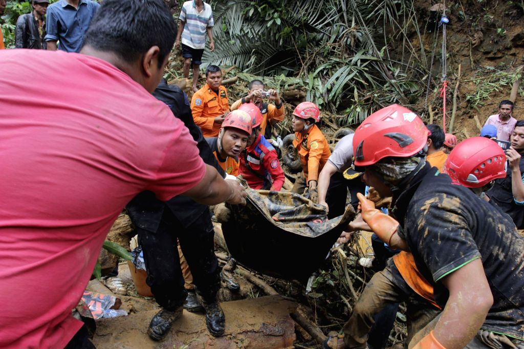 WEST SUMATRA, March 4, 2017 - Search and rescue team transfer a body at Koto Alam village of Limapuluh Kota district in West Java, Indonesia, March 4, 2017. Landslides and floods have left at least ...