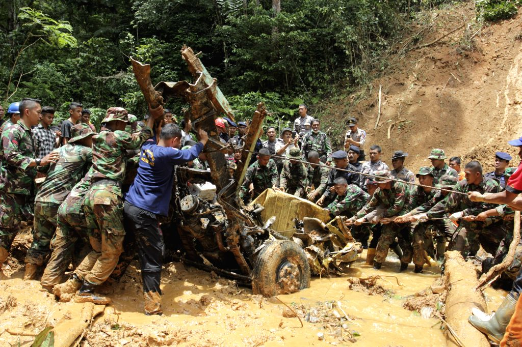 WEST SUMATRA, March 4, 2017 - Soldiers try to dig out bodies from a vehicle at Koto Alam village of Limapuluh Kota district in West Java, Indonesia, March 4, 2017. Landslides and floods have left at ...