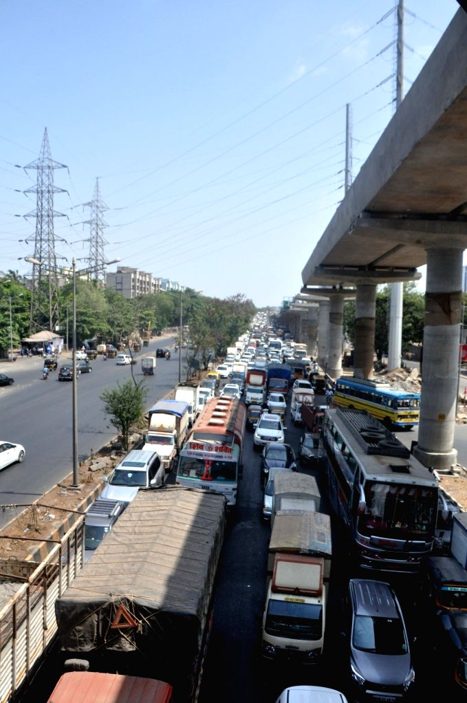 Western Express Highway witnessed massive traffic jam after a BPCL tanker with 20,000 litre diesel which caught fire on Western Express Highway flyover, while proceeding from Goregaon to ...