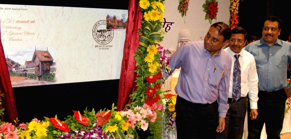 Western Railways General Manager Hemant Kumar and Mumbai Region Post Master General Harish Agrawal release a special postal envelope to commemorate 150th year of Western Railways in Mumbai on April ..