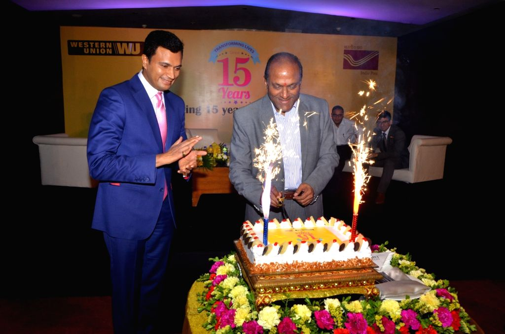 Western Union India and South Asia MD and regional vice president Kiran Shetty and India Post member (Banking and HRD) MS Ramanujan launch a special postal cover during a programme ... - Kiran Shetty