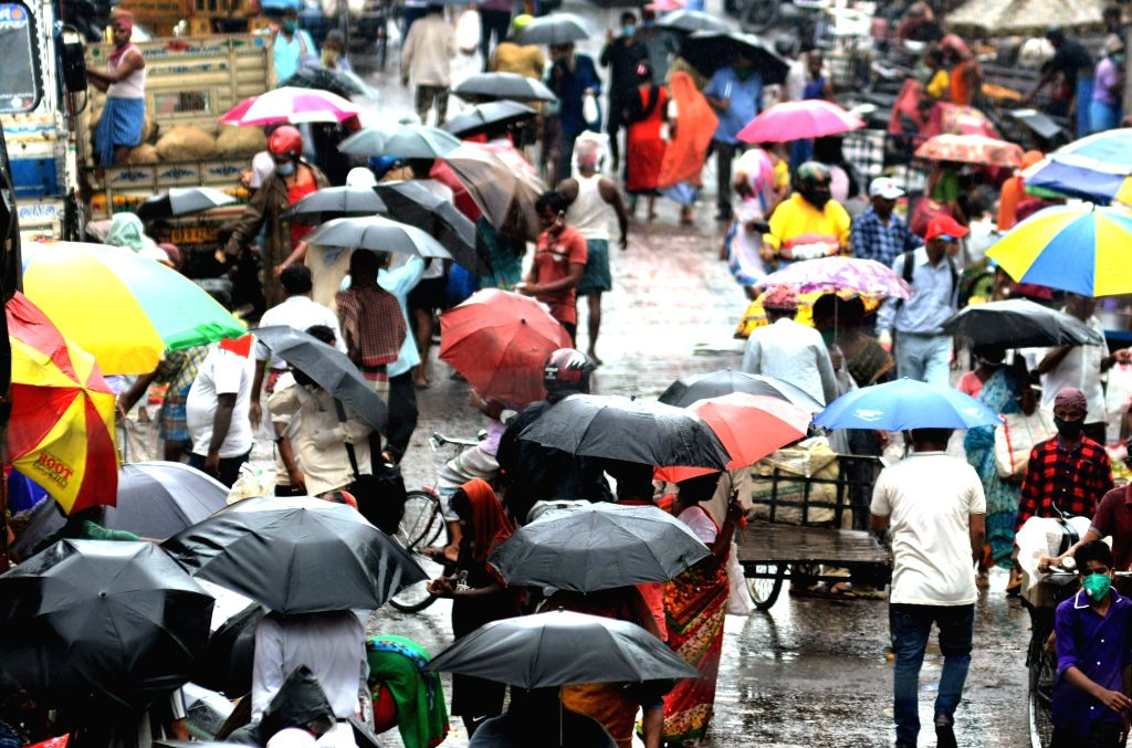 While people use umbrellas to shield themselves during rains, social distancing goes for a toss at a Kolkata market amid COVID-19 pandemic, on Sep 1, 2020.