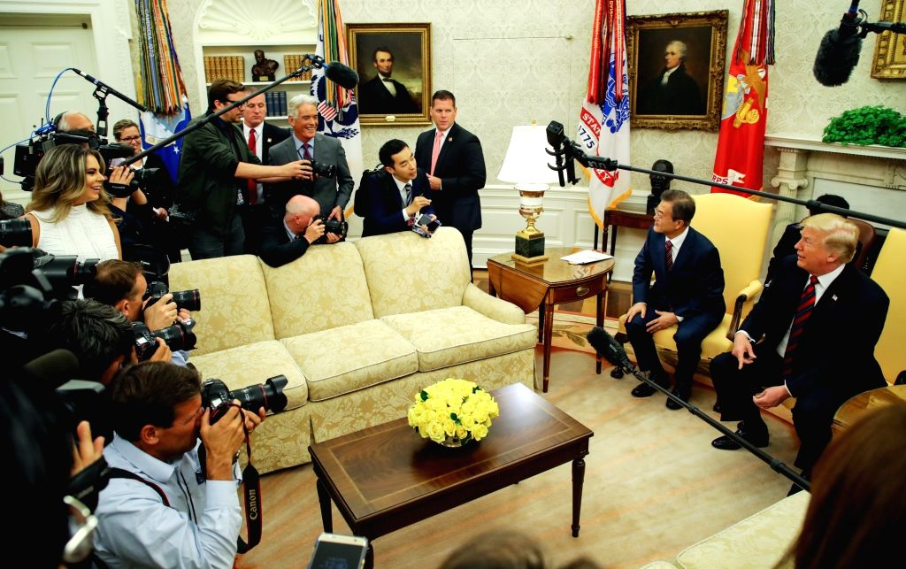 White House: South Korean President Moon Jae-in (2nd from R) and U.S. President Donald Trump (R) respond to reporters' questions before their one-on-one summit talks at the White House on May 22, ...
