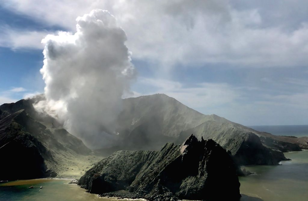 WHITE ISLAND, Dec. 10, 2019 (Xinhua) -- Photo taken on Dec. 9, 2019 shows the White Island after volcanic eruption in New Zealand. Two Chinese nationals were among those injured in the volcanic eruption on the White Island in the Eastern Bay of Plent