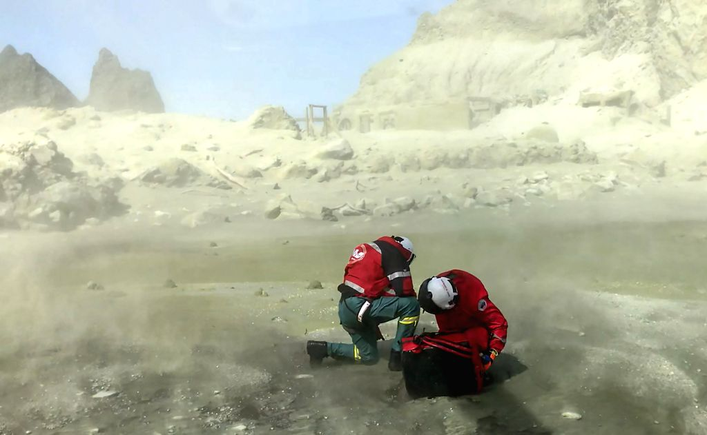 WHITE ISLAND, Dec. 10, 2019 (Xinhua) -- Rescuers land on the White Island after volcanic eruption in New Zealand, Dec. 9, 2019. Two Chinese nationals were among those injured in the volcanic eruption on the White Island in the Eastern Bay of Plenty o