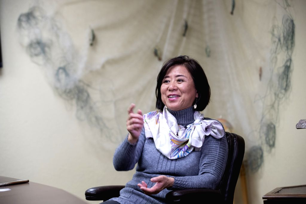 WICKLIFFE, Dec. 5, 2019 - Angie Yu, an initiator of the International Fisheries Industrial Park and president of Two Rivers Fisheries, receives an interview with Xinhua at her company in Ballard ...