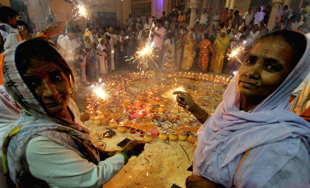 Widows celebrate Diwali at Radha Krishna temple in Vrindavan of Uttar Pradesh's Mathura district on Oct 27, 2016.