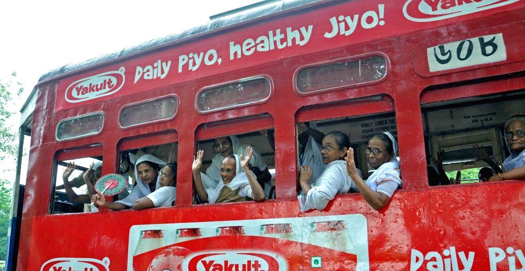 Widows from Vrindavan enjoy a tram ride on International Widow's Day 2016 in Kolkata, on June 23, 2016.