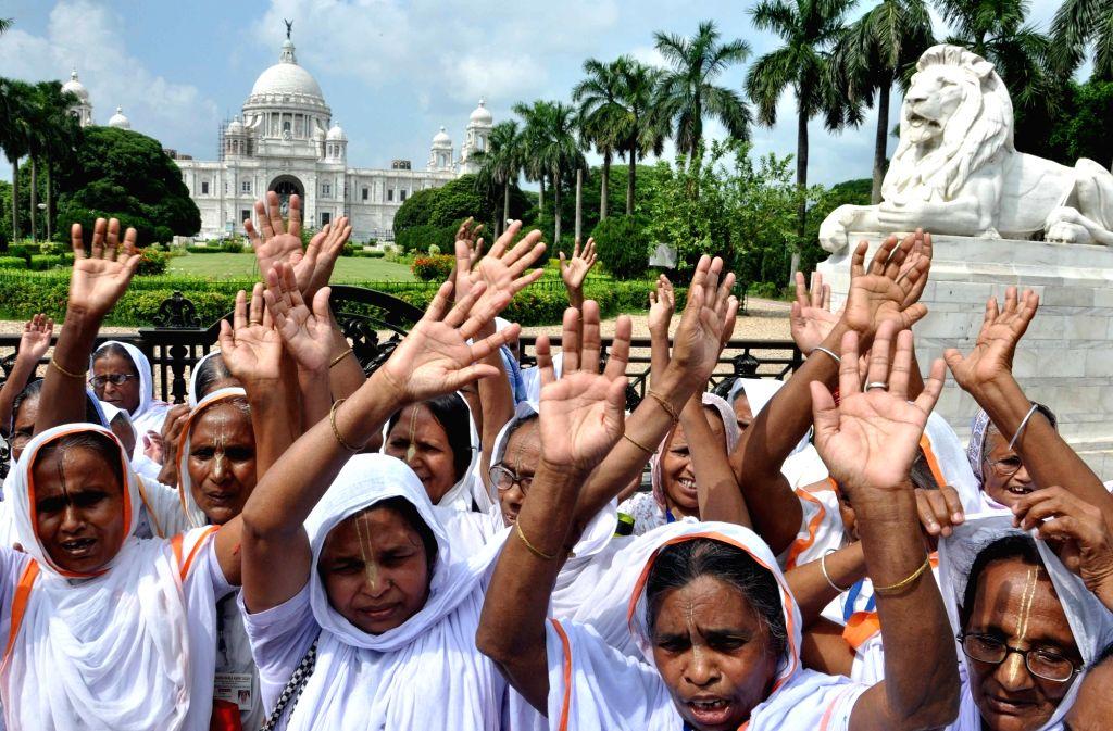 Widows from Vrindavan visit Victoria Memorial on International Widow's Day 2016 in Kolkata, on June 23, 2016.