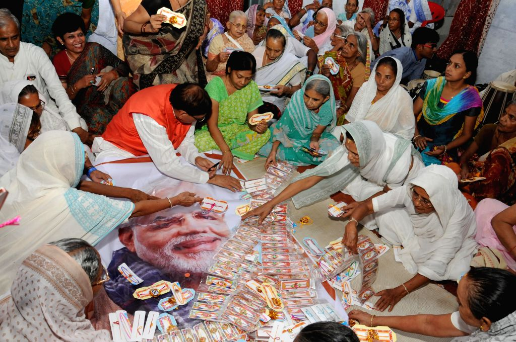 Widows prepare a thousand rakhis for Prime Minister Narendra Modi in Varanasi on Aug 3, 2014. - Narendra Modi