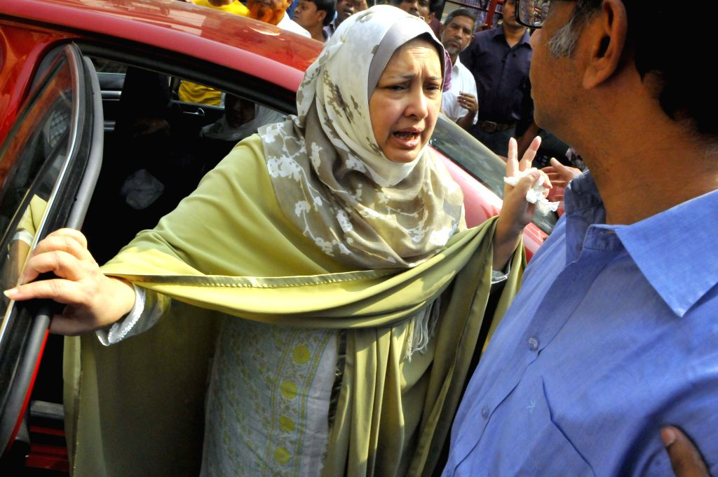 Wife of death row criminal Salauddin Quader Chowdhury, a leader of Bangladesh Nationalist Party (BNP), arrives to meet him in front of the gate of the Central Jail in ...