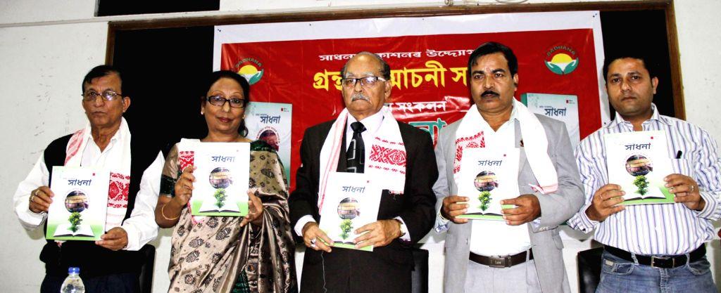 Wife of eminent writer late Nirod Choudhury, Indira Choudhury and other dignitaries release the 2nd edition of the book `AhejarJon Kobir Hridayar Anubhab` in Guwahati on Dec.8, 2013. - Nirod Choudhury and Indira Choudhury