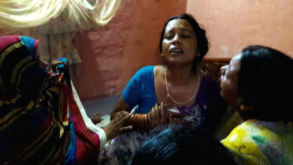 Wife of Havildar Ashok Kumar Singh who was killed in the terror attack on Uri army camp mourn his death in Bhojpur district of Bihar on Sept 19, 2016.