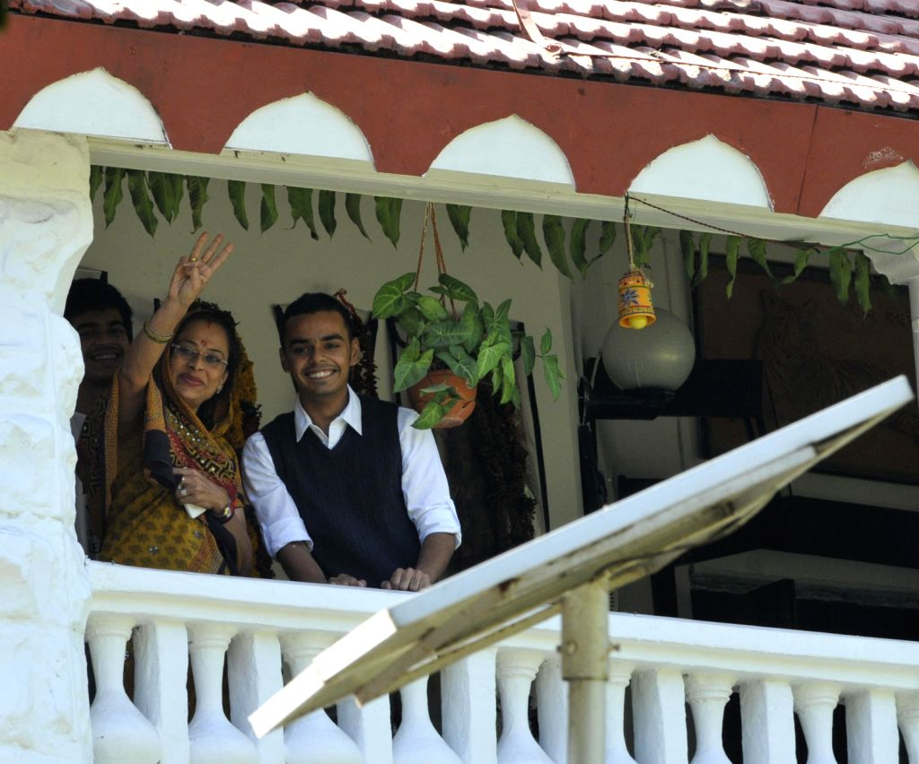 Wife of Madhya Pradesh Chief Minister Shivraj Singh Chouhan, Sadhna Singh  and his son Kartikeya Singh Chouhan wave from the balcony of Chief Minister's residence after results of Madhya Pradesh - Sadhna Singh