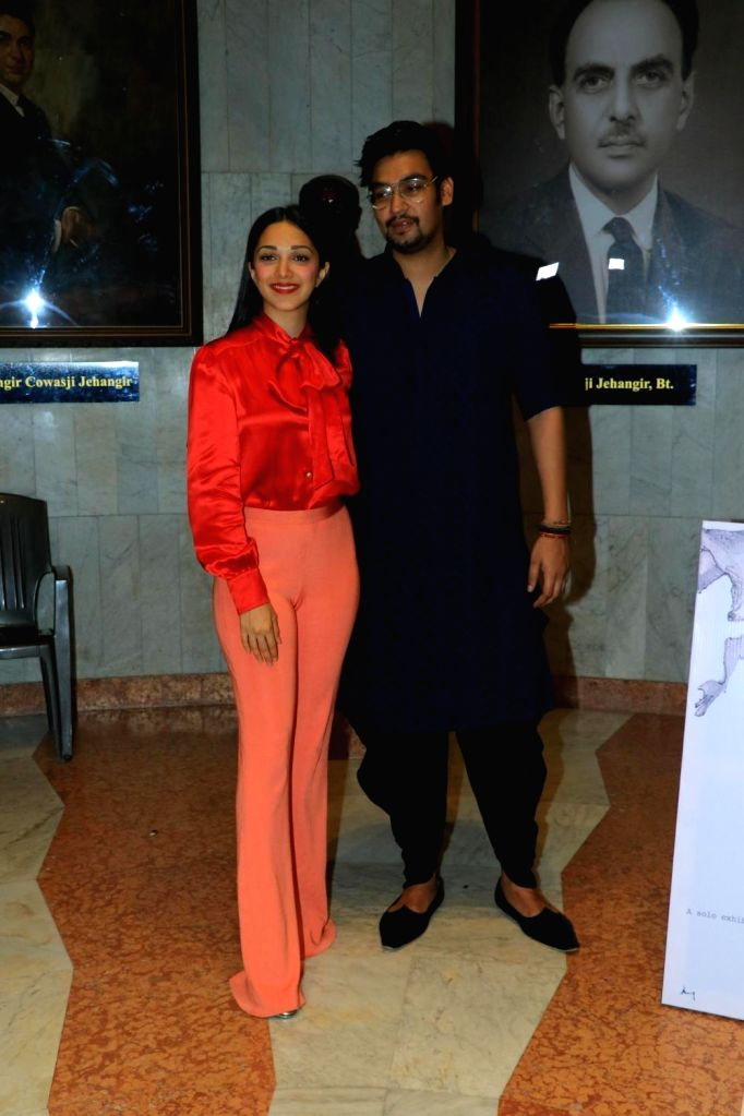 Wildlife conservationist and photographer Aditya Singh with actress Kiara Advani at his exhibition in Mumbai on Oct 15, 2019. - Kiara Advani and Singh
