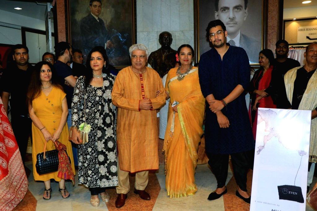 Wildlife conservationist and photographer Aditya Singh with Activist, poet, lyricist and screenwriter Javed Akhtar and his wife Shabana Azmi at his exhibition in Mumbai on Oct 15, 2019. - Shabana Azmi and Singh