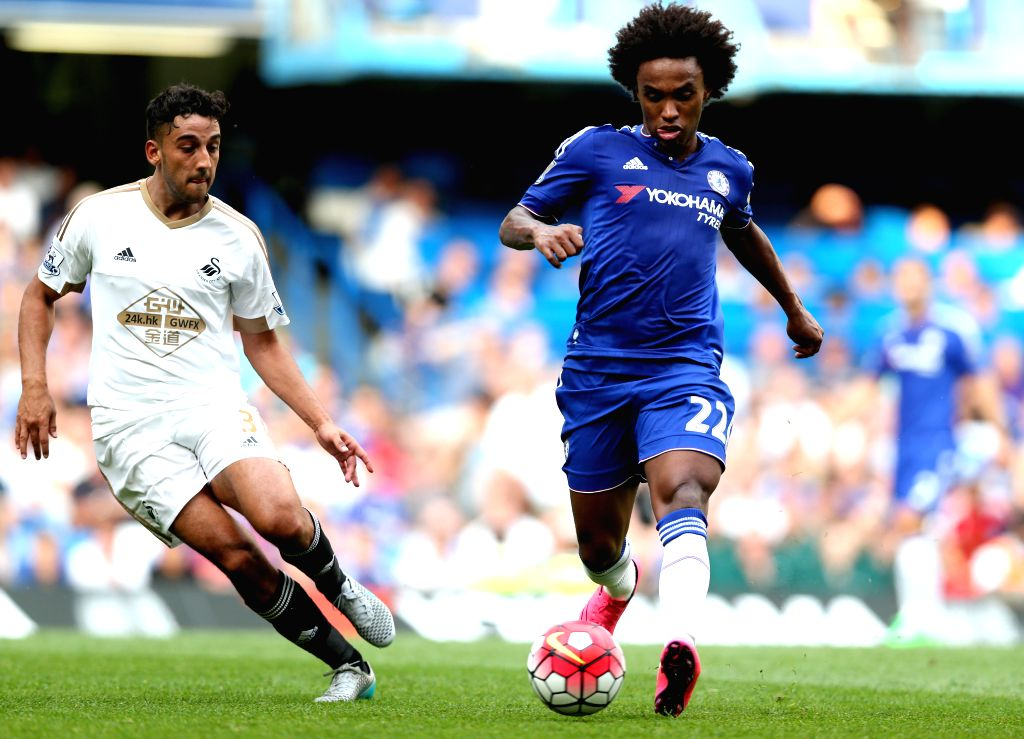 William (R) of Chelsea vies with Neil Taylor of Swansea City during the Barclays Premier League match between Chelsea and Swansea City at the Stamford Bridge stadium ...