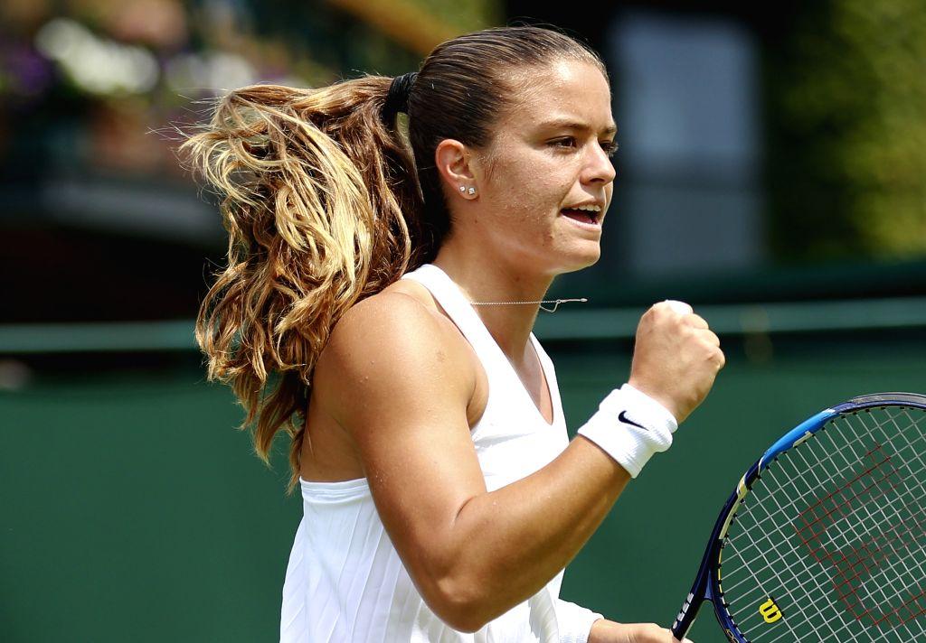 WIMBLEDON, June 27, 2016 - Maria Sakkari of Greece celebrates a point against Zheng Saisai of China during the women's singles first round match at the 2016 Wimbledon Championships in Wimbledon, ...