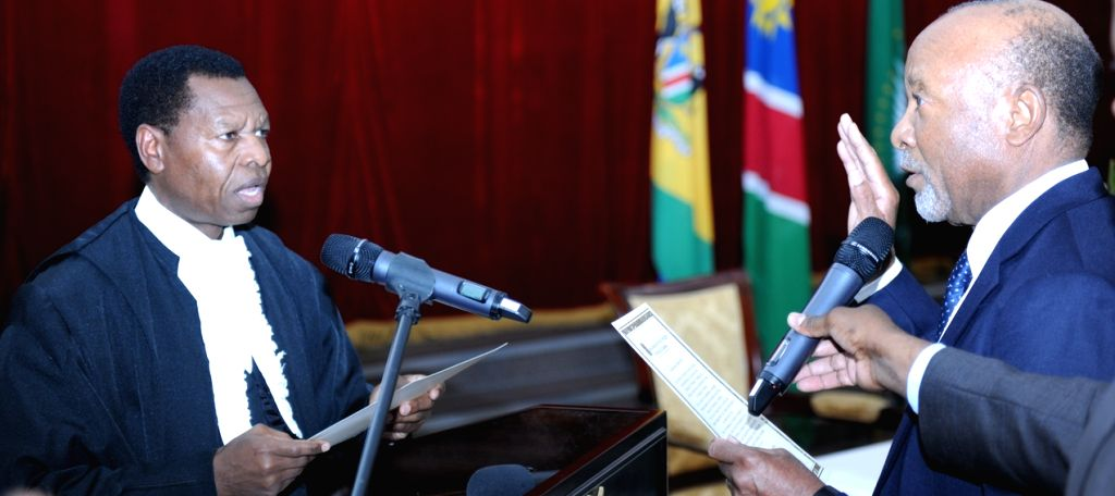 WINDHOEK, Feb. 12, 2018 - Nangolo Mbumba (R) is sworn in as the new Vice President of Namibia by Chief Justice Peter Shivute in Windhoek, capital of Namibia, on Feb. 12, 2018. Former secretary ...
