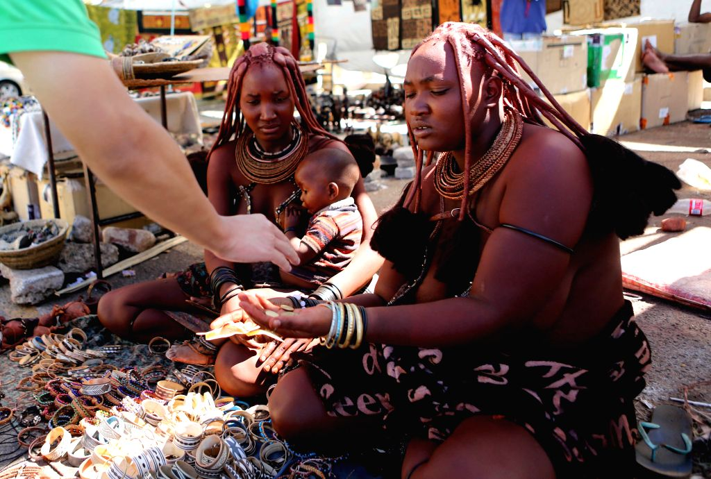 Windhoek (Namibia): Himba women peddle handicrafts at a business street in Windhoek, Namibia, on Nov. 30, 2014. The Himba are indigenous people living in northwestern Namibia.
