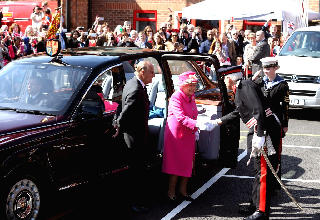 WINDSOR, April 20, 2016 - Queen Elizabeth II (2nd L) attends a celebration to mark the 500th anniversary of the Royal Mail postal service at the Royal Mail Delivery Office in Windsor, western London, ...