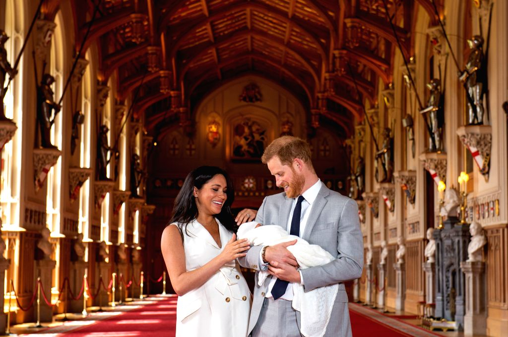 WINDSOR, May 8, 2019 (Xinhua) -- Britain's Prince Harry, Duke of Sussex (R), and his wife Meghan Markle, Duchess of Sussex, pose for a photo with their son in St George's Hall at Windsor Castle in Windsor, Britain, on May 8, 2019. The baby boy, who i