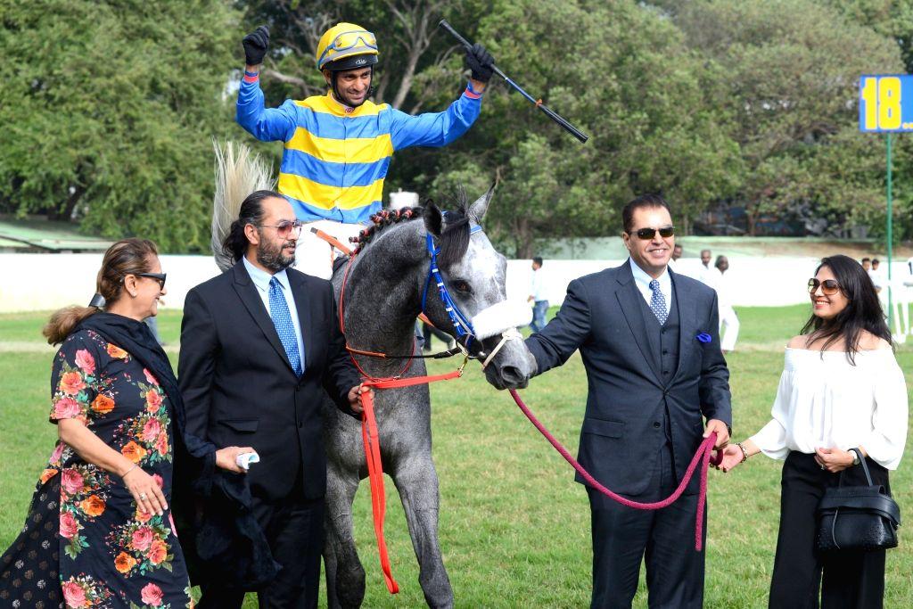 Winner Jockey Trevor Patel astride on Sir Cecil horse exults after winning the Kingfisher Ultra Derby 2018 at Race Course, in Bengaluru on July 15, 2018. - Jockey Trevor Patel