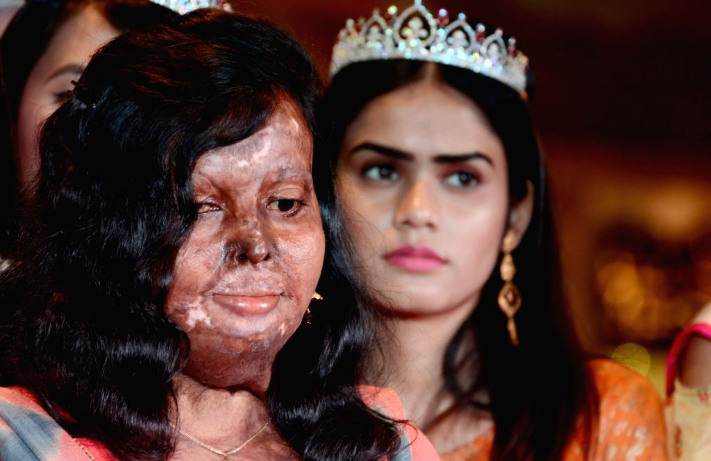 Winners of fbb Colors Femina Miss India - East Zone, with acid attack survivor during a programme, in Kolkata, on April 25, 2019.