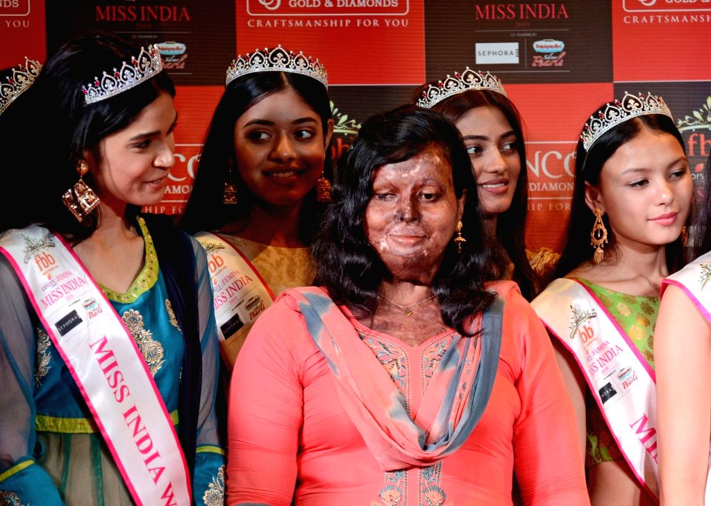 Winners of fbb Colors Femina Miss India - East Zone, with acid attack survivors during a programme, in Kolkata, on April 25, 2019.