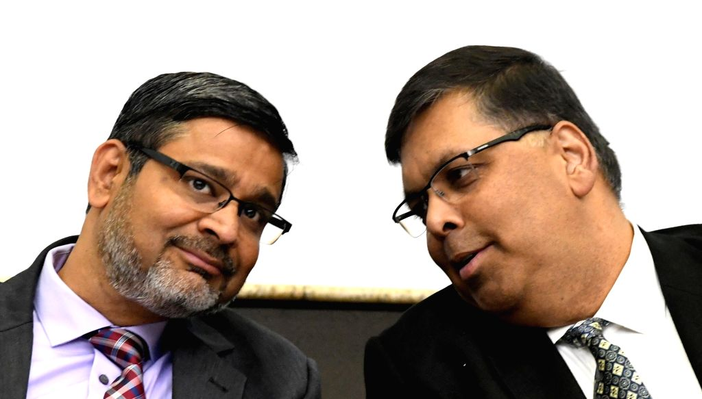 Wipro CEO and Executive Director Abidali Z Neemuchwala and Senior Vice President and Global Head (HR) Saurabh Govil during a programme organised to announce financial results of third ...