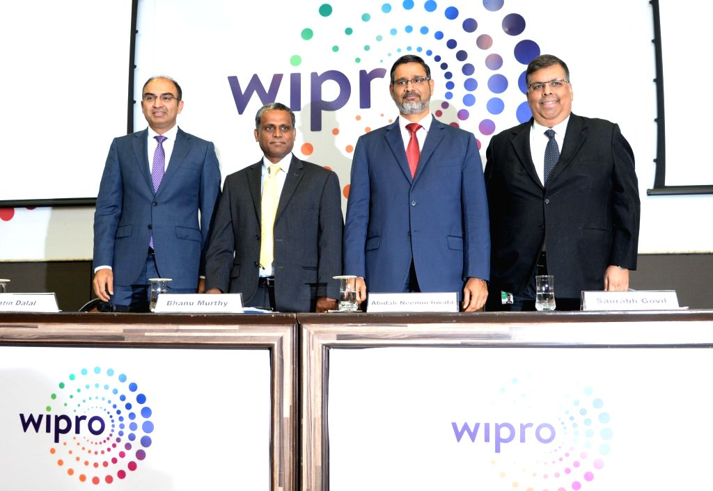 Wipro CFO Jatin Dalal, President and COO B.M. Bhanumurthy, CEO Abidali Z. Neemuchwala during a press conference organised to announce Q1 financial results of FY 2018-19 in Bengaluru, on ...