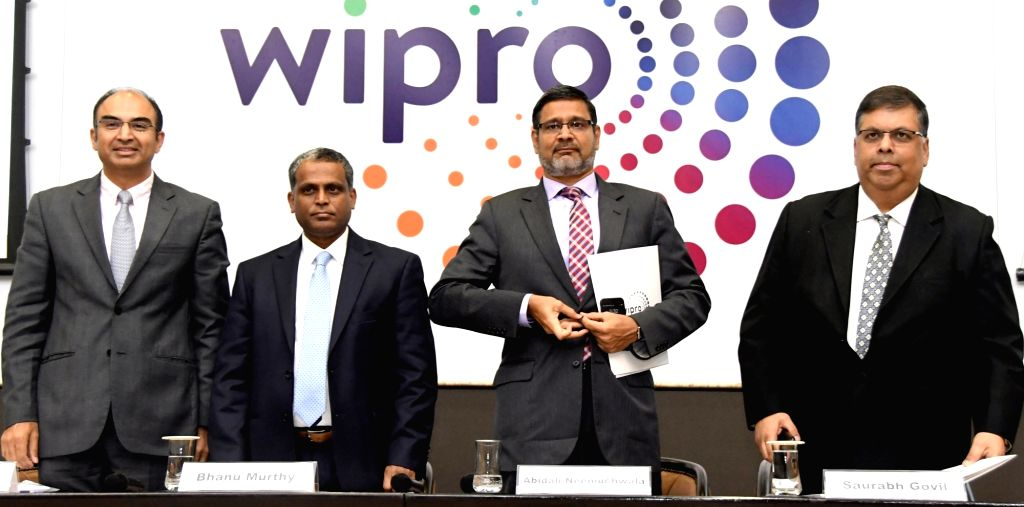 Wipro CFO Jatin Dalal, President and COO B. M. Bhanumurthy, Wipro CEO and Executive Director Abidali Z Neemuchwala and Senior Vice President and Global Head (HR) Saurabh Govil during a ...