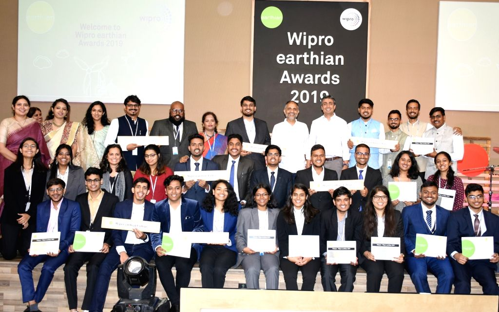 Wipro Chairman Rishad Premji and Chief Sustainability Officer Anurag Behar pose with the winners of 'Wipro earthian Awards 2019' at Wipro Campus, in Bengaluru on Feb 8, 2020.