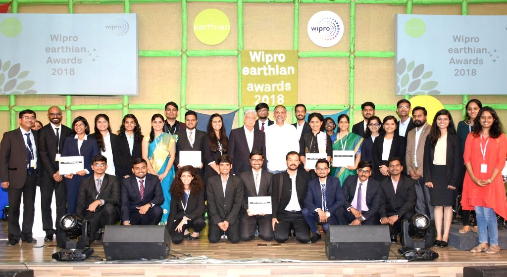 Wipro Limited Chairman Azim Premji and Chief Sustainability Officer Anurag Behar with winners of the Wipro earthian Awards 2018 during a programme in Bengaluru, on Feb 9, 2019.