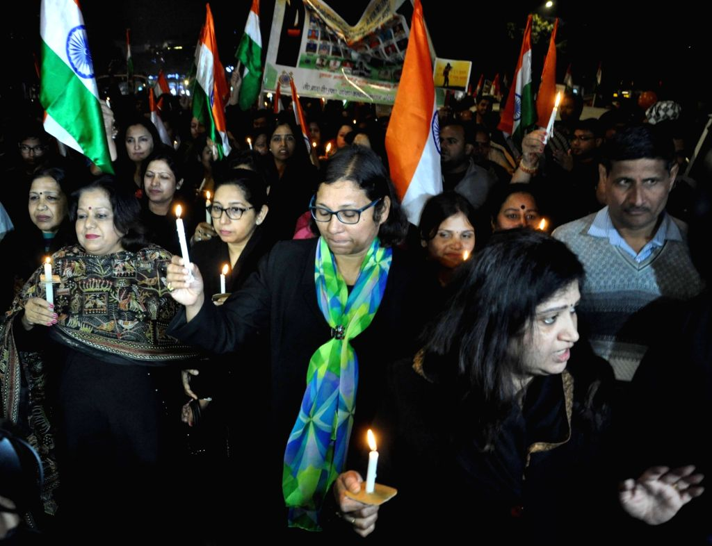 Wives of CRPF personnel participate in a candle light vigil to protest against 14 Feb Pulwama militant attack in which 49 CRPF men were killed; in New Delhi on Feb 16, 2019.