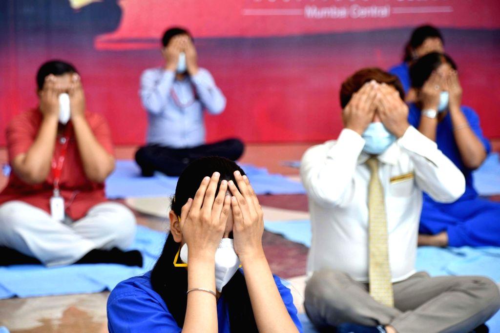Wockhardt Hospital, Mumbai Central doctors, nurses and ward boys attending a yoga session on World International Yoga Day on in Mumbai on Saturday 19 June, 2021.