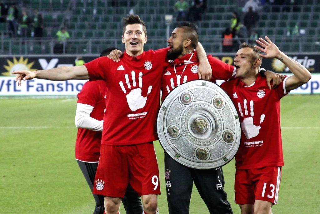 WOLFSBURG, April 30, 2017 - Bayern Munich's Robert Lewandowski(L), Arturo Vidal (C) and Rafinha celebrate winning the title after the German Bundesliga match between VfL Wolfsburg and Bayern Munich ...